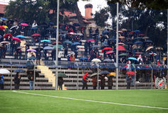 Soccer under the rain. Sorrento supporters with umbrellas are watching the italian professional football match sorrento-pisa under the rain.18/12/11 Stock Photography