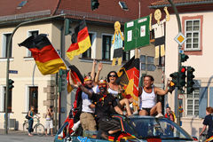 Soccer: German Fans. After the victory of the geman soccer team, fans celebrated hilariously the whole night through with car parades, vouvouzelas and hissed Stock Photo