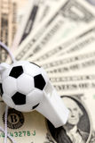 Soccer whistle on dollar notes Stock Photography