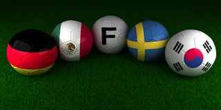 Soccer World Cup 2018 balls with the flag of Group F Germany Mex. Ico Sweden South Korea on the green grass of stadium Royalty Free Stock Images