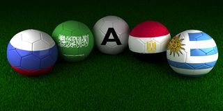 Soccer World Cup 2018 balls with the flag of Group A Russia Saud. I Arabia Egypt Uruguay on the green grass of stadium Royalty Free Stock Photos