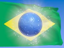 Soccer World Cup 2014 Brazil. Brazil flag with blue soccer ball, symbolic for the soccer World Cup 2014 Stock Image