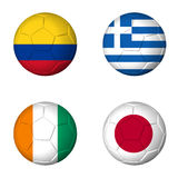 Soccer world cup 2014 group C flags on soccerballs. Soccer world cup 2014 group C flags on soccer balls. 3D rendered Stock Photo