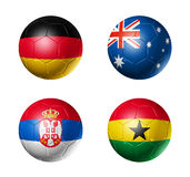 Soccer world cup group D flags on soccer balls. 3D soccer balls with group D teams flags, world football cup 2010. isolated on white Royalty Free Stock Photos