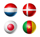 Soccer world cup group E flags on soccer balls. 3D soccer balls with group E teams flags, world football cup 2010. isolated on white Royalty Free Stock Images