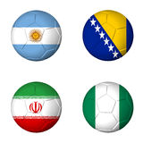 Soccer world cup 2014 group F flags on soccerballs. Soccer world cup 2014 group F flags on soccer balls. 3D rendered Royalty Free Stock Photography