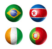 Soccer world cup group G flags on soccer balls. 3D soccer balls with group G teams flags, world football cup 2010. isolated on white Royalty Free Stock Image