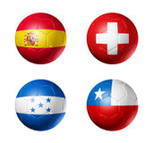 Soccer world cup group H flags on soccer balls. 3D soccer balls with group H teams flags, world football cup 2010. isolated on white Royalty Free Stock Photo