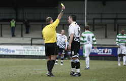 Soccer Yellow Card. NEATH, WALES - MARCH 13: Ashley Evens (right) of Neath is shown the yellow card during their Welsh Premier League match against The New Royalty Free Stock Photo