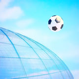 Soccerball against the background of the sky. Royalty Free Stock Photos