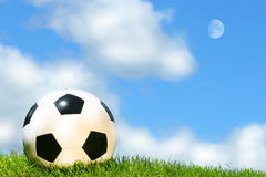 Soccerball against a blue sky Royalty Free Stock Images