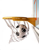 Soccerball centering the basket, close up view. Royalty Free Stock Images