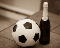 Soccerball and champagne Stock Images