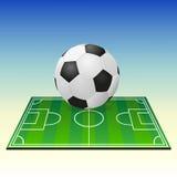 Soccerball en un campo de fútbol Fotografía de archivo