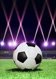 Soccerball in feestelijke verlichting Stock Fotografie
