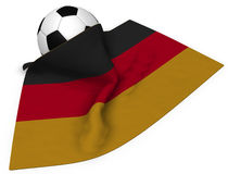 Soccerball and flag of germany Stock Images