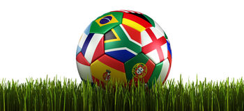 Soccerball with flags in grass Royalty Free Stock Photo