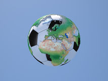 Soccerball with Globe: Europe and Africa. In front of Blue Sky Royalty Free Stock Image
