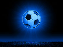 Soccerball with grass horizon line. A 3D stylized illustration of a soccerball in combination with a grass horizon and slight background glow Royalty Free Stock Photography