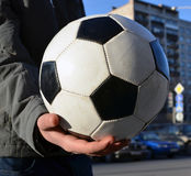 Soccerball in hand of teenager. future champion. Royalty Free Stock Images