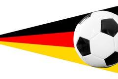 Soccerball med det tyska banret Arkivfoton