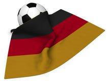 Soccerball och flagga av Tyskland stock illustrationer