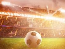 Soccerball på stadion under solnedgång stock video