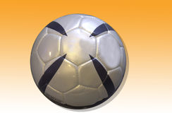 Soccerball. A silver and black soccerball on an orange background Royalty Free Stock Images