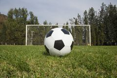 Soccerball2. Soccer ball waiting to be kicked in front of a soccer goal Royalty Free Stock Image