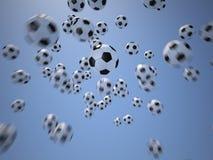 Soccerballs framme av blå himmel Royaltyfri Bild