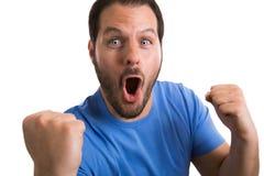 Soccerballventilator met blauw overhemd die het succes van zijn team vieren stock foto