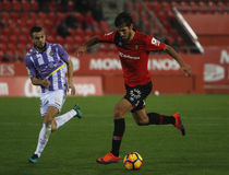 Soccers players during a football match between Real Valladolid and Real Mallorca in the stadium of Son Moix. Stock Photos