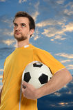Socer Player Holding Ball Stock Photo