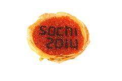 Sochi 2014 red caviar pancake Royalty Free Stock Images