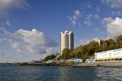 Sochi beach. Sochi is the popular resort on Black Sea shore, the big building's name is The Alexandria Lighthouse Royalty Free Stock Photos