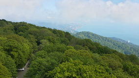 Sochi coast from the height, green hills and the Black Sea. Sochi coast from the height, the green expanses of forest and mist over the Black Sea Royalty Free Stock Images