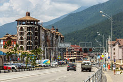 Sochi, Krasnaya Polyana. View of Estonskaya Street. Sochi, Krasnodar region. Estonskaya Street in Krasnaya Polyana against the background of a mountain landscape Royalty Free Stock Photos
