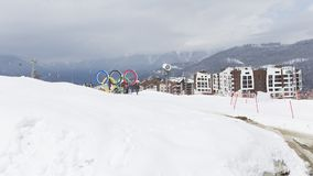 Tourist group near the Olympic rings, Sochi. Sochi - March 29, 2017: A group of people near the Olympic rings in the Olympic skiing cluster March 29, 2017, Sochi Stock Photo