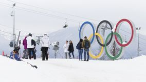 People are photographed near the Olympic rings, Sochi. Sochi - March 29, 2017: Men and women photographed near the Olympic rings in the Olympic ski cluster March Royalty Free Stock Photos