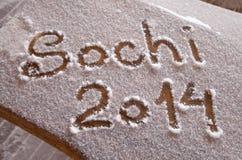 Sochi-Olympics 2014 geschrieben auf den Schnee mit einem Finger Stockfotos