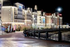 Sochi, Rosa Khutor, ski resort built for Winter Olympic Games 2014, Russia - April 21, 2018. Night view on embankment of. River Mzymta after rain. Gorisontal Royalty Free Stock Photography