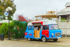 SOCHI,RUSSIA, 18 APRIL 2019-  bright red and blue retro food truck with coffee on wheels on street. Bright red and blue retro food truck with coffee on wheels on royalty free stock image