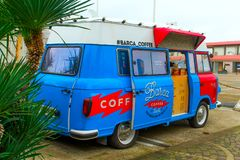 SOCHI,RUSSIA, 18 APRIL 2019-  bright red and blue retro food truck with coffee on wheels on street. Bright red and blue retro food truck with coffee on wheels on stock photos