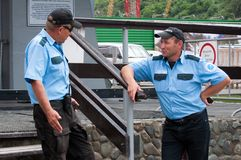 The conversation of two guards at the entrance to the Gornaya Karusel ski lift, Sochi Stock Image