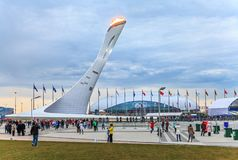 Huge Olympic Torch erection with burning flame in Olympic Park was main venue of Sochi Winter Olympics. Sochi, Russia - February 15, 2014: Huge Olympic Torch royalty free stock photos