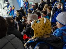 Sochi. Russia - February 16, 2014: Little fans in the stands of the hockey match royalty free stock photos