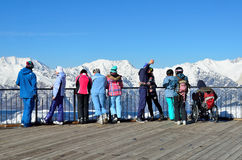 Sochi, Russia, February, 29, 2016, Ski resort Rosa Khutor. People look at of mountains from the observation deck of Rosa peak Stock Image