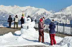 Sochi, Russia, February, 27, 2016, Ski resort Rosa Khutor. People look at of mountains from the observation deck of Rosa peak Royalty Free Stock Photography
