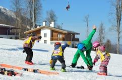Sochi, Russia, February, 27, 2016, Ski resort Rosa Khutor. Teaching children skiing, warm-up. Sochi, Russia, February, 27, 2016. Teaching children skiing, warm Royalty Free Stock Photos