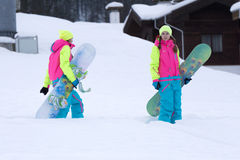 SOCHI, RUSSIA - FEBRUARY 26, 2014: Two girls go Royalty Free Stock Photography